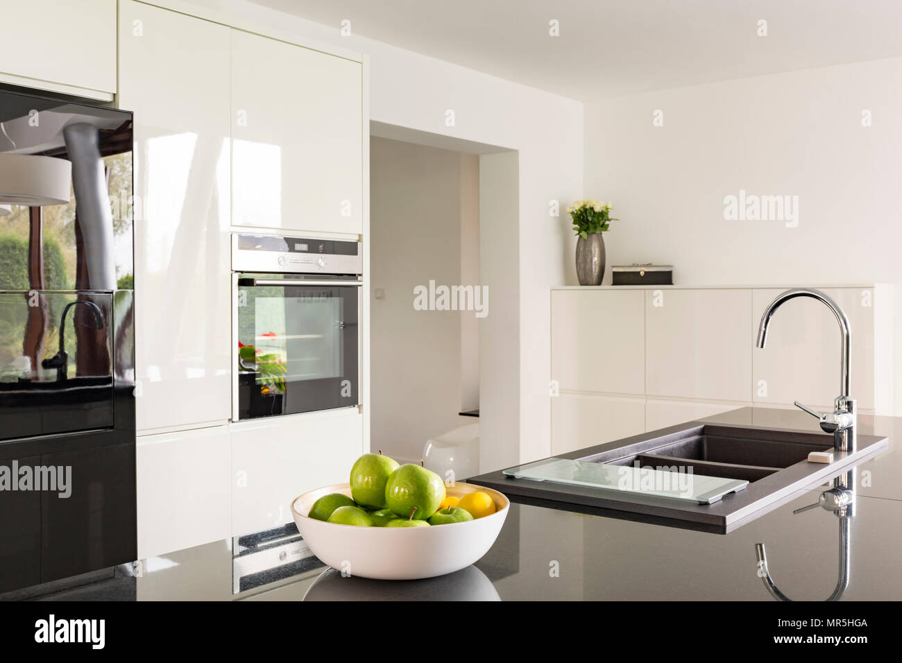 White Gloss Kitchen With Black Worktops on black with white kitchen floor, black with white doors, black with white drawers,
