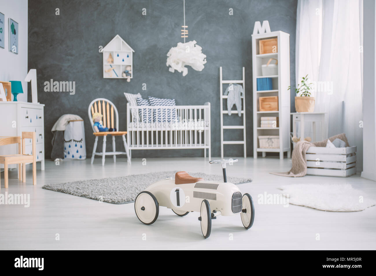Spacious Baby Room With White Cot Bookcase And Dresser