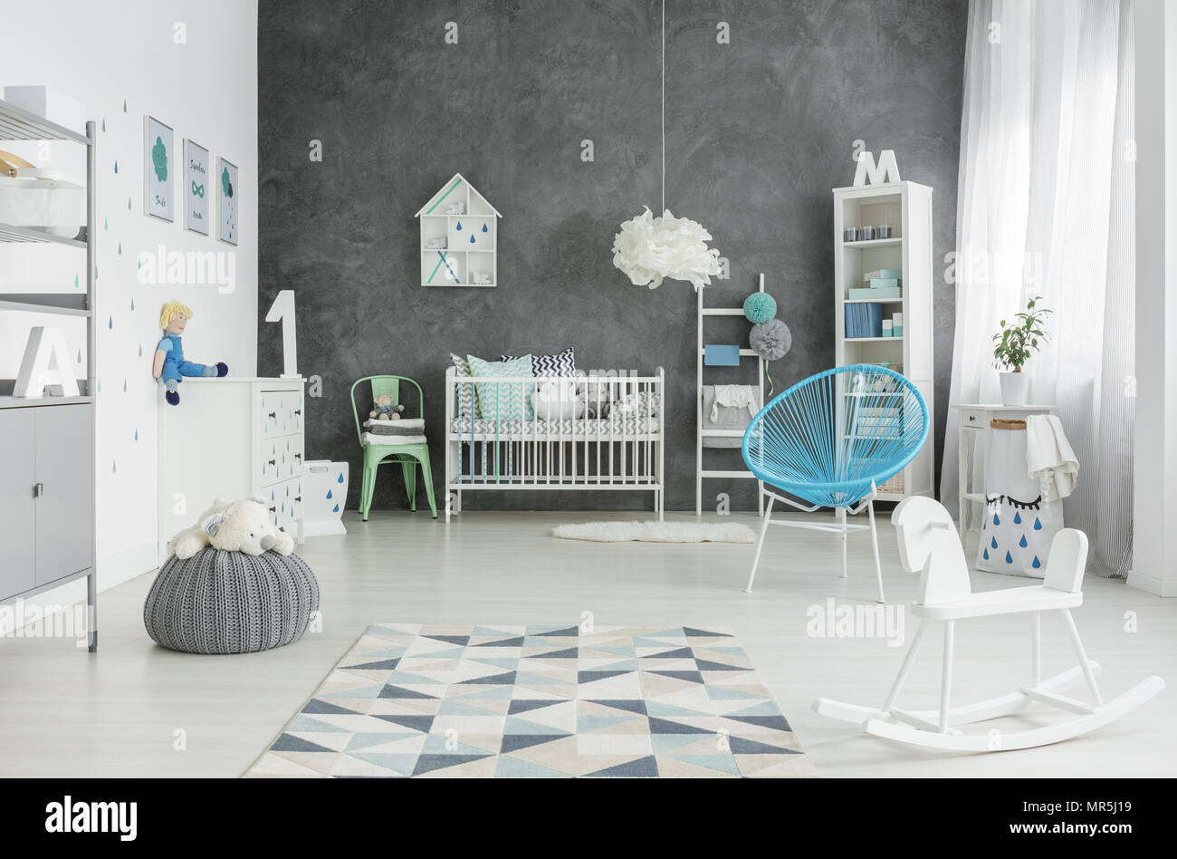 Scandi Style Spacious Child Room With Cot Bookshelf And Dresser