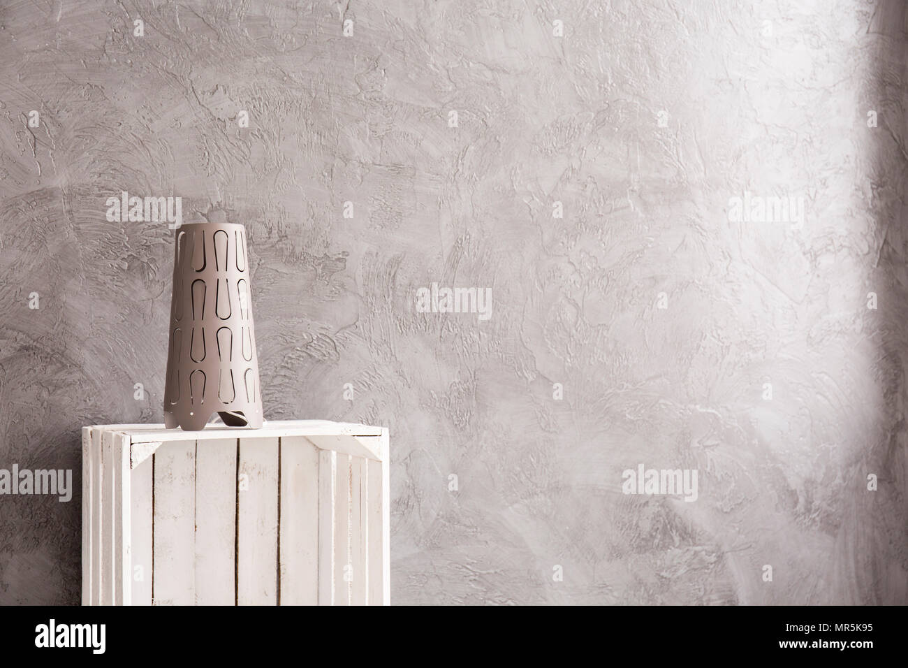 Interior with grey wall, home decoration standing on white, wood box Stock Photo