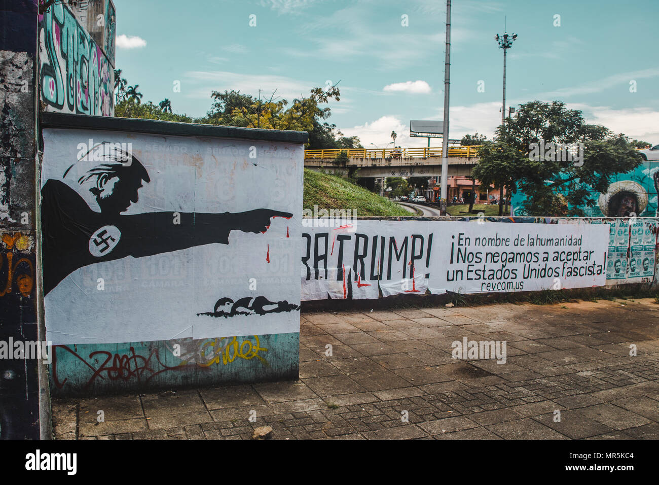 Anti-Trump graffiti on a wall in Cali, Colombia, that reads in Spanish, 'In the name of humanity, we refuse to accept a fascist United States' - Stock Image