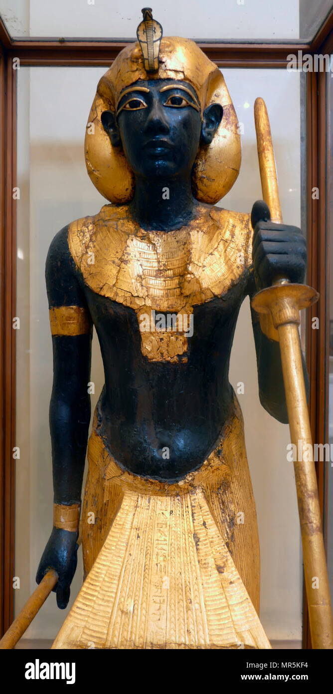 gilded wooden guardian statues from King Tutankhamen's burial chamber. Tutankhamen was an Egyptian pharaoh of the 18th dynasty (ruled c. 1332–1323 BC), during the period of Egyptian history known as the New Kingdom - Stock Image