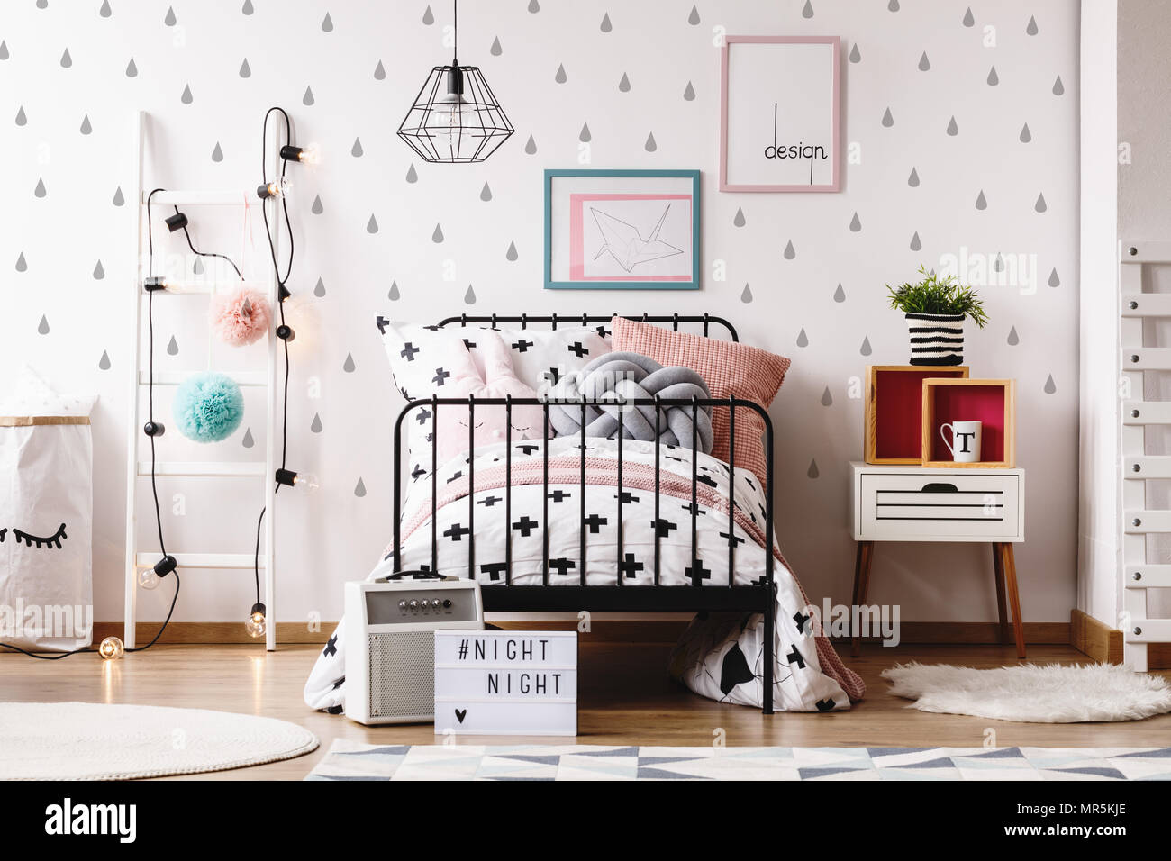Cute Pillows On Bed Against White Wallpaper With Grey Teardrops In