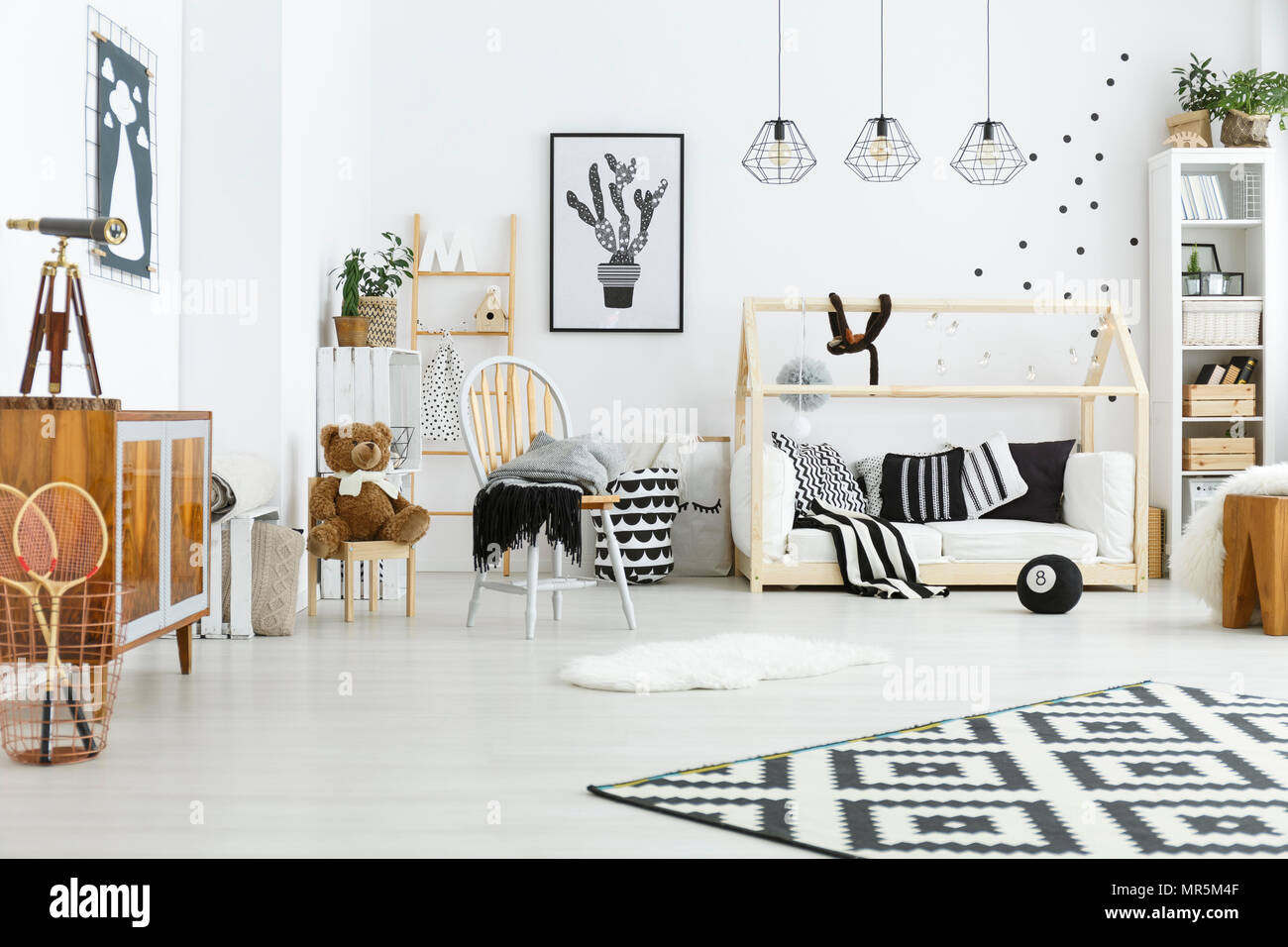Kids Room With House Bed Dresser Chair And Bookshelf