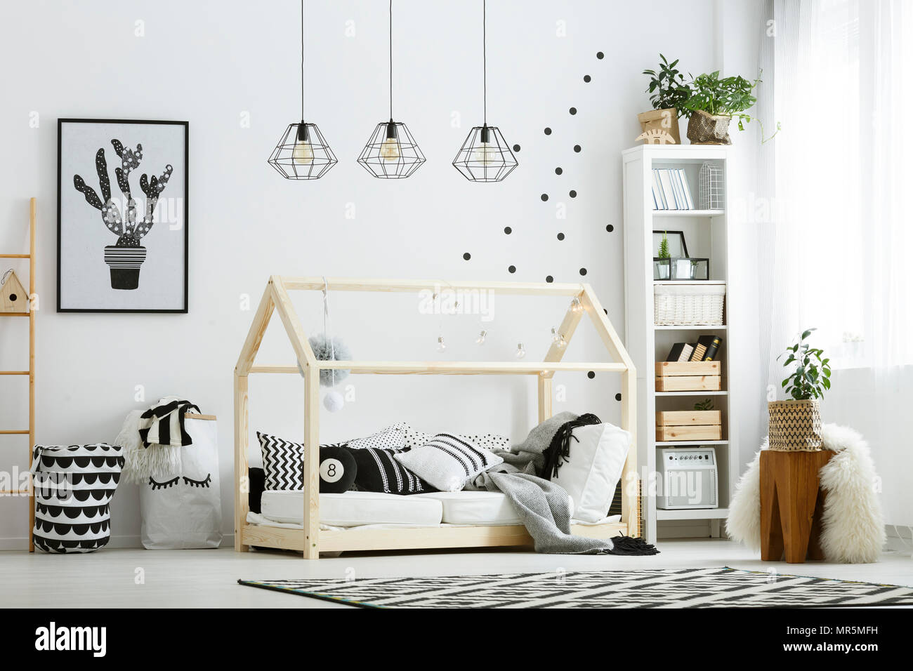 Modern Baby Bedroom In White With Bed Bookcase And Carpet