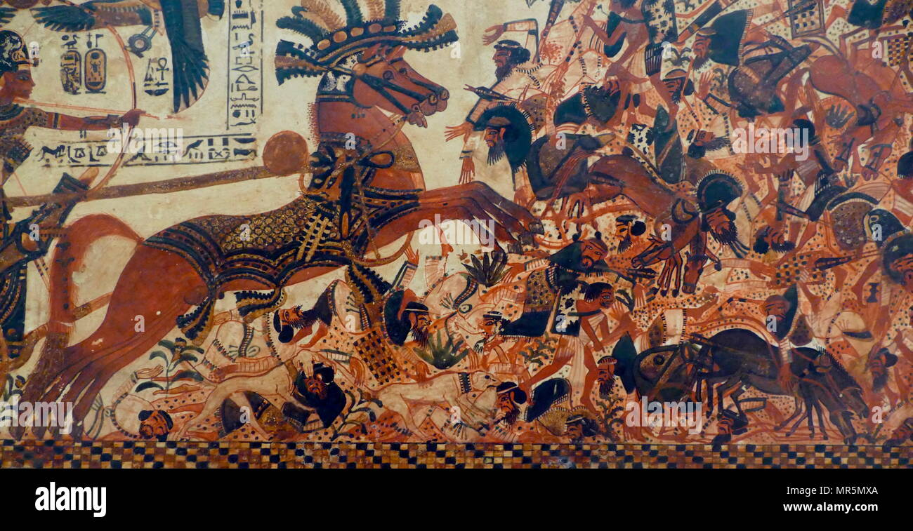 18th dynasty, Egyptian wooden chest depicting a hunting scene on one side and King Tutankhamen crushing enemies on the other side. 1323 BC - Stock Image