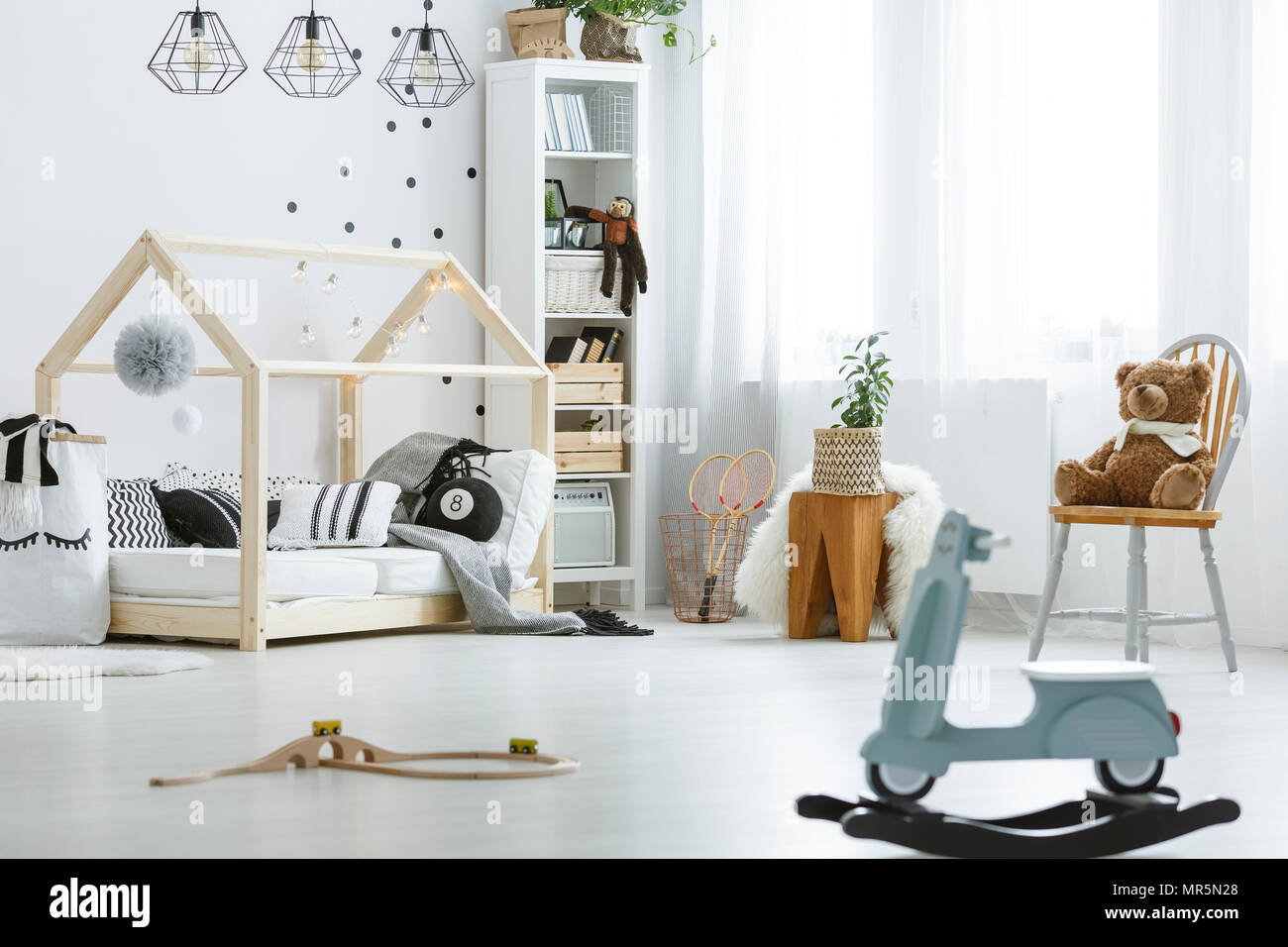 White Child Room With Toys Bed Lamps Chair And Bookcase