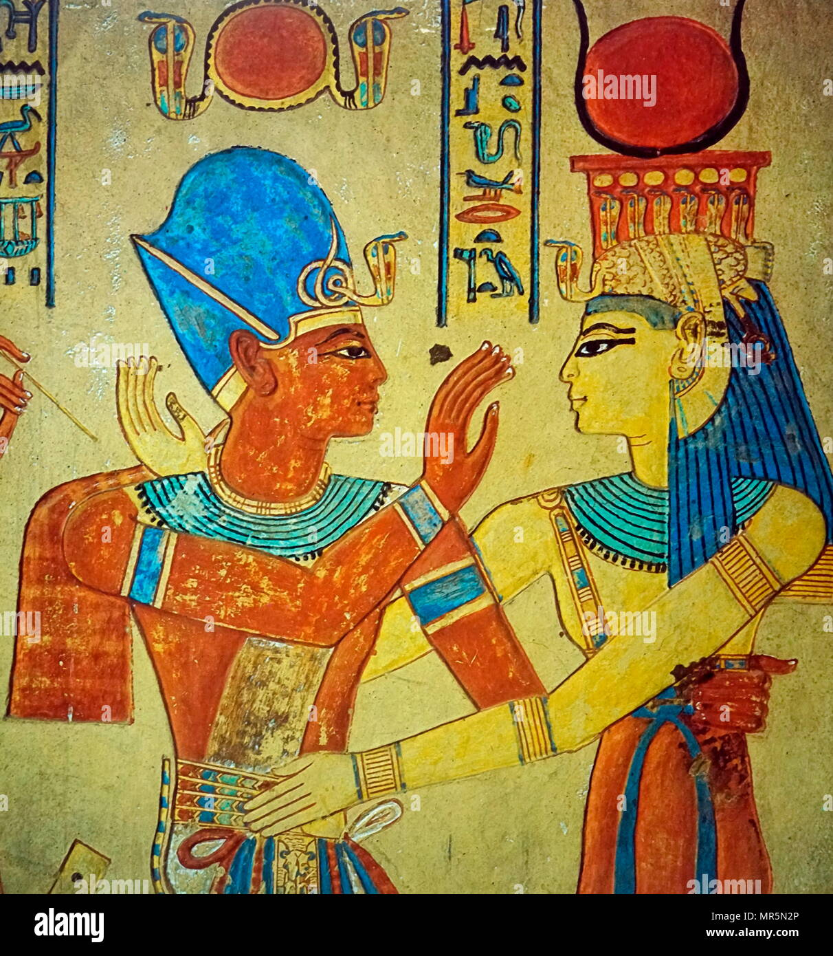 Relief from the Tomb  of Prince Amunherkhepeshef (Twentieth Dynasty). Valley of the Kings. The goddess Isis depicted embracing Ramesses III. Usimare Ramesses III (also written Ramses and Rameses) was the second Pharaoh of the Twentieth Dynasty and is considered to be the last monarch of the New Kingdom to wield any substantial authority over Egypt - Stock Image