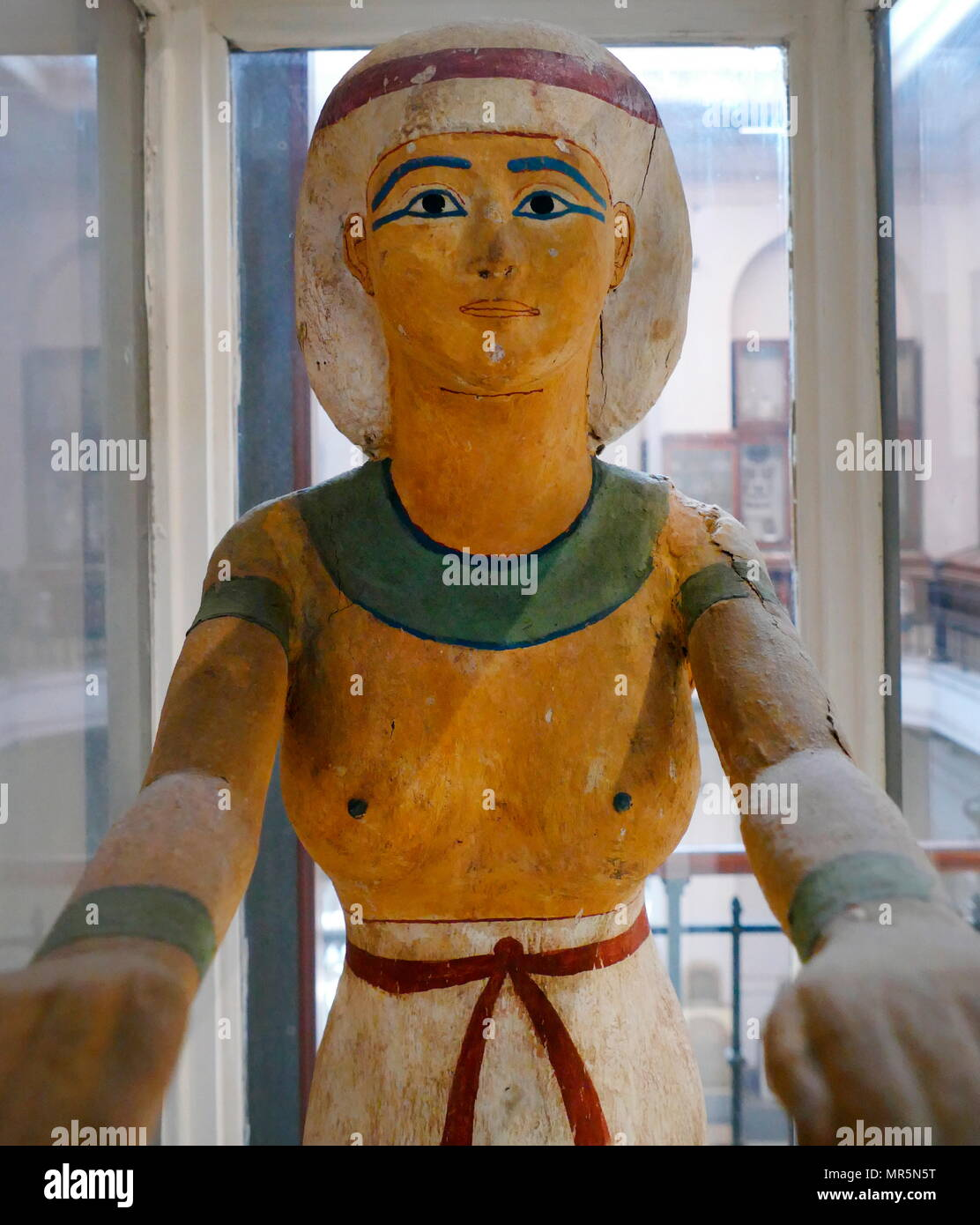 Statue of Nephtys, 21st Dynasty (c. 1070 - 946 BC). Cachette of the priests of Ajnun, Deir el-Bahari Statue of Isis wearing transparent dress tied with long belt. Her wig is circled and tied with band. She is sketching her arms to receive the deceased - Stock Image
