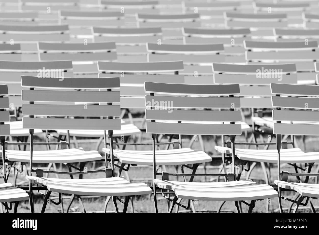 White chair rows in a spa park in Black & White medium light Stock Photo