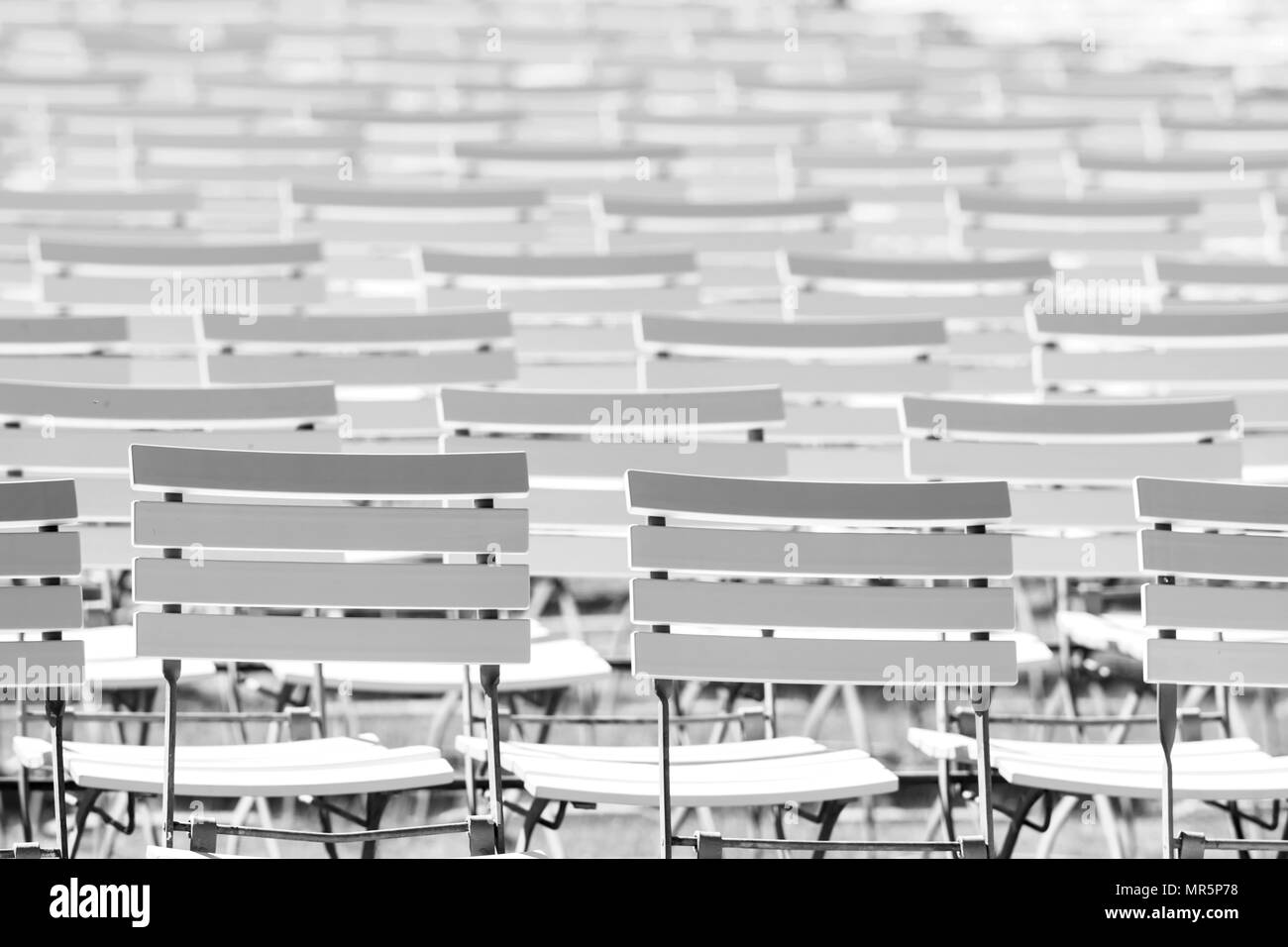 White chair rows in a spa park in Black & White bright light - Stock Image