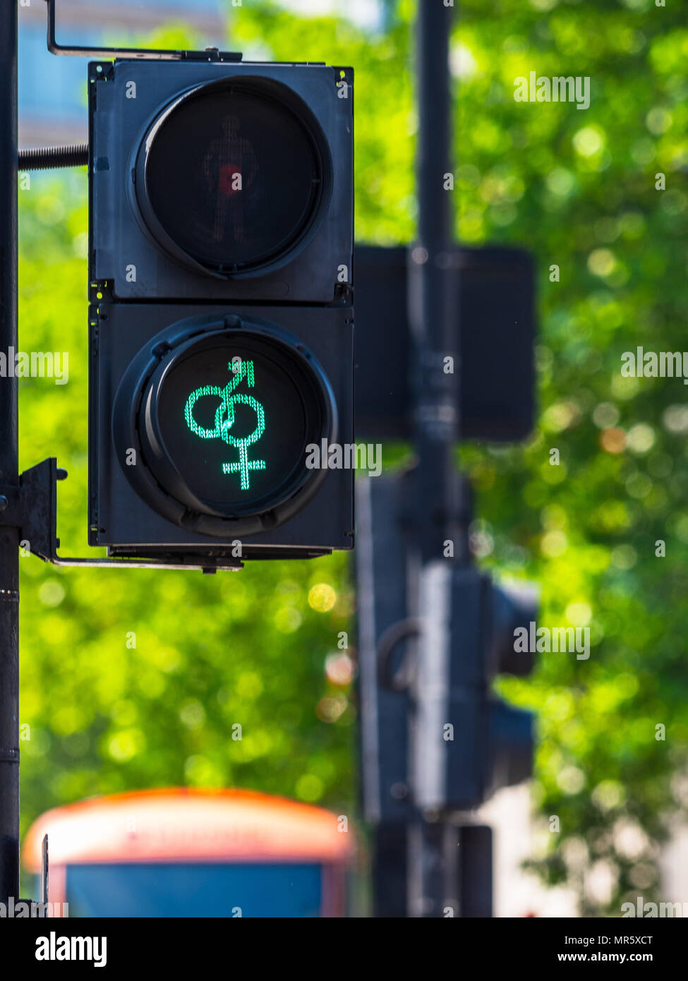 LGBT traffic Lights at Trafalgar Square in central London UK - installed as part of the London Pride festival - Stock Image