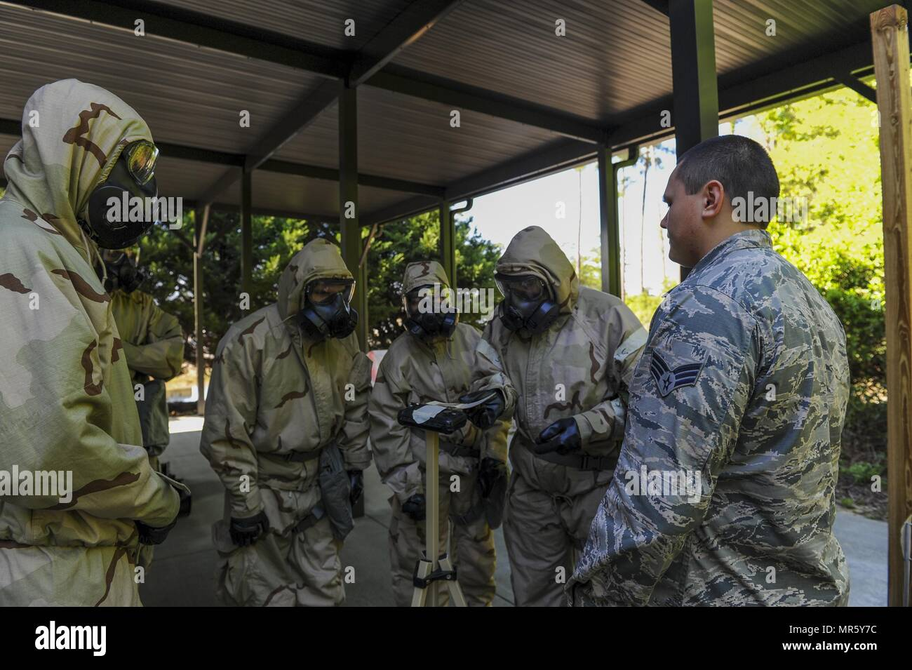 Air Commandos attended a chemical, biological, radiological and nuclear survival skills class at Hurlburt Field, Fla., April 4, 2017. The skills taught during CBRN Survival Skills prepare Air Commandos for the possibility of a CBRN related attack. Without it, Airmen could be left vulnerable to terrorist or state use of CBRN weapons. The CBRN Survival Skills class teaches Air Commandos how to properly inspect, don and wear the Chemical Protective Overgarment in case of a chemical warfare related attack. - Stock Image