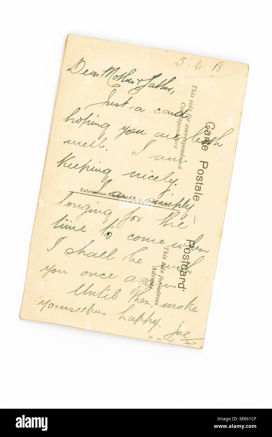 message to parents written on the back of a First World War hand embroidered silk postcard - see image MR61D4 for the front of the card - Stock Image
