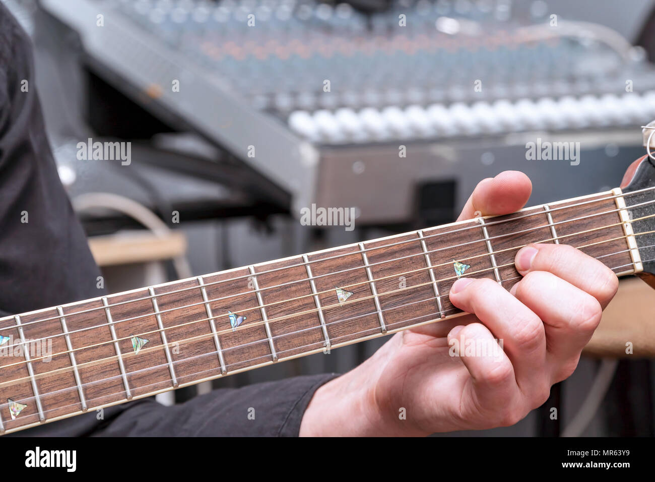 The Hand Of The Guitarist On The Fingerboard Chord In D Major Stock