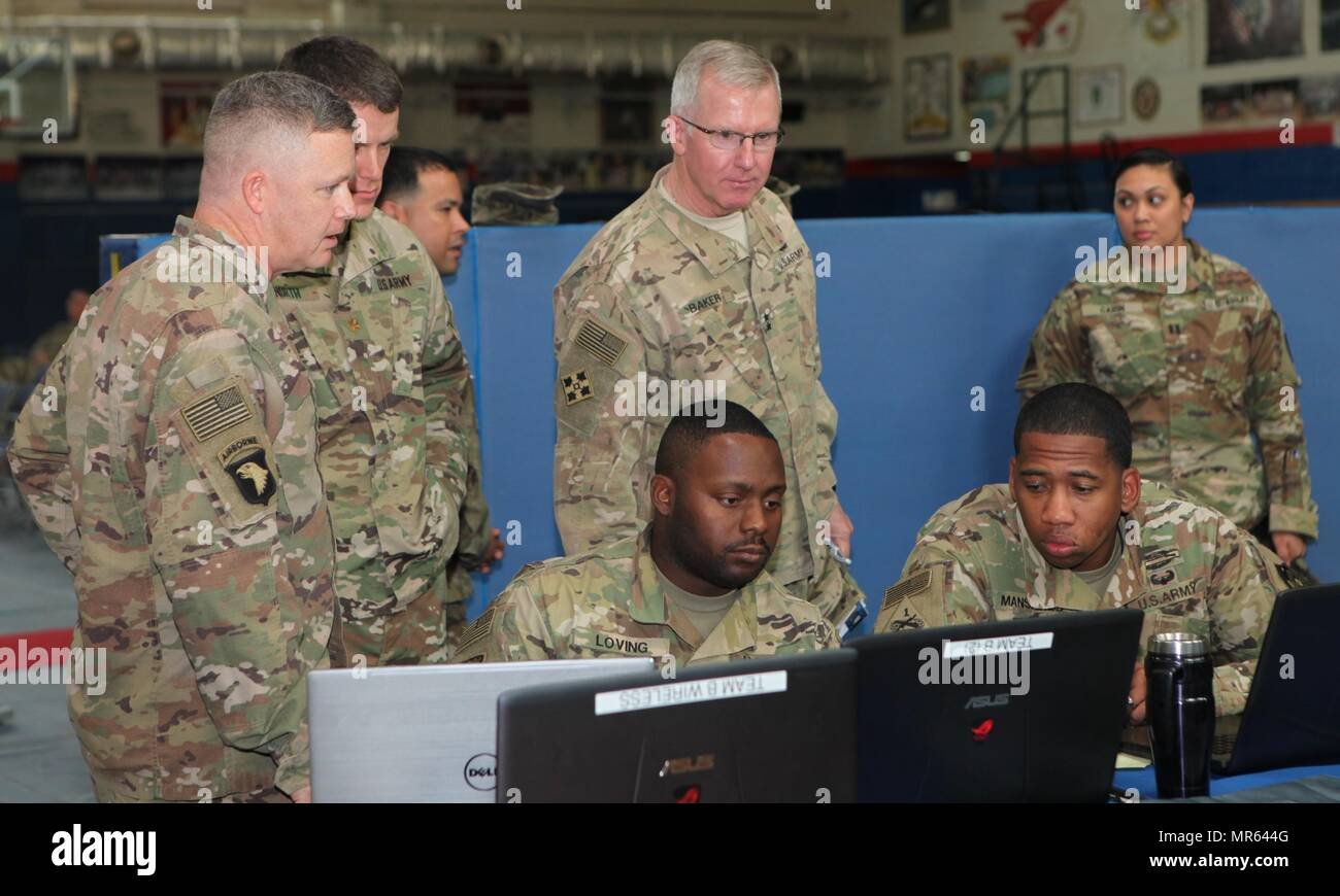 Maj. Gen. John Baker, Commanding General, NETCOM, visits the Cyber Range at the Cyber Bowl III during his battlefield circulation at Camp Arifjan, Kuwait on 27 April 2017.  Soldiers from the Regional Cyber Center South West Asia, show Maj. Gen. Baker the way the Cyber Range was designed for this year's competition.  The range covered a wide array of topics including network sniffing, packet capture, packet analysis and social engineering among others. (U.S. Army photo by Capt. Sandra Richards) - Stock Image