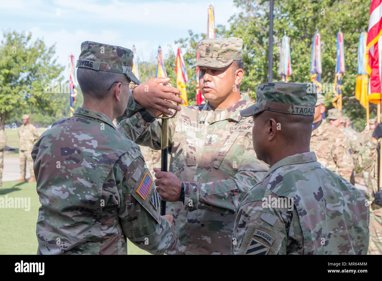 Maj. Gen. Leopoldo Quintas (left), the 3rd Infantry Division commander, passes a saber to Sgt. Maj. Steven Cisneros, the 3rd ID operations sergeant major at a relinquishment of responsibility ceremony at Fort Stewart, Ga. on May 19, 2017. 3rd ID Command Sgt. Maj. Walter Tagalicud relinquished responsibility at the ceremony and moves on to serve as command senior enlisted advisor for I Corps at Joint Base Lewis-McChord, Wash. (U.S. Army photo by Capt. Jarrod Morris) Stock Photo