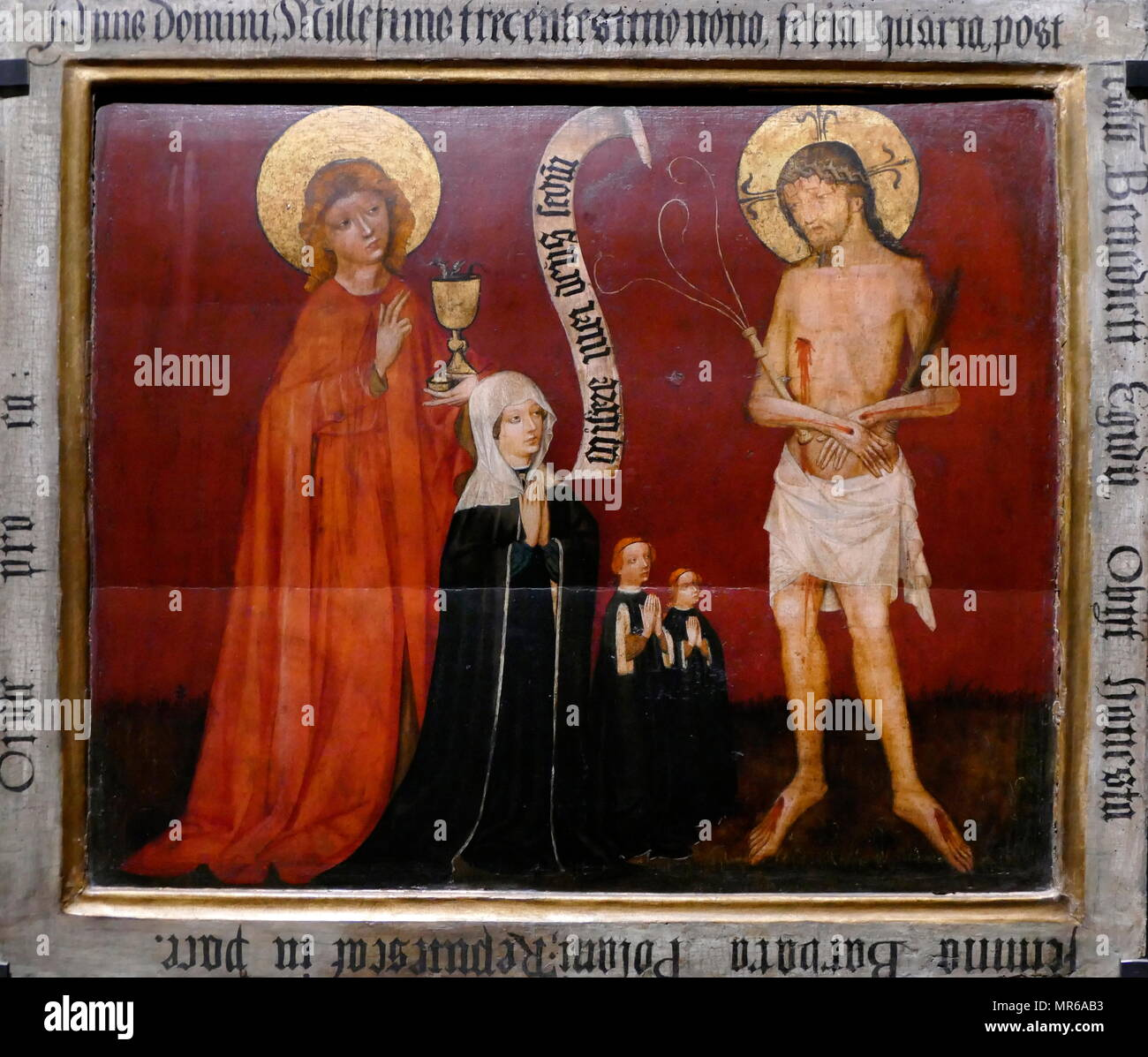 Lime wood panel depicting the Epitaph of Barbara Polaini. From St barbara's Church in Wroclaw (Breslau), Poland. Circa 1409 - Stock Image