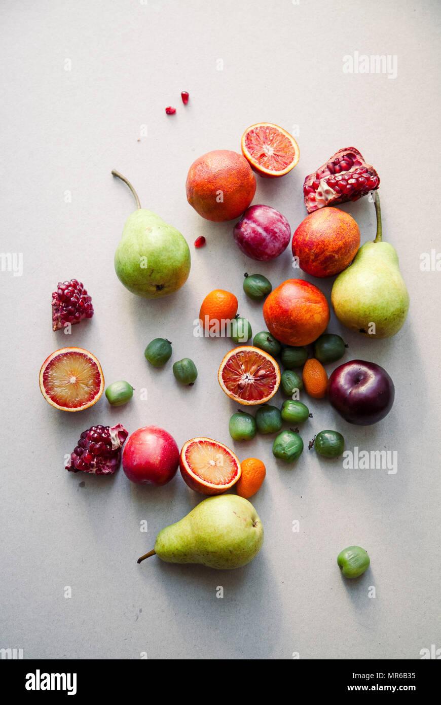 Varitety of fresh summer fruits on neutral background - Stock Image