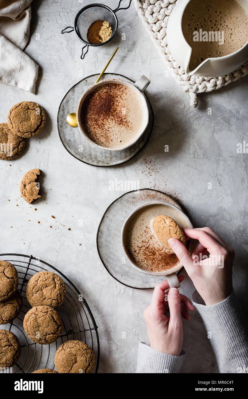 Vegan Cashew Gingersnap Lattes with ginger cookies Stock Photo