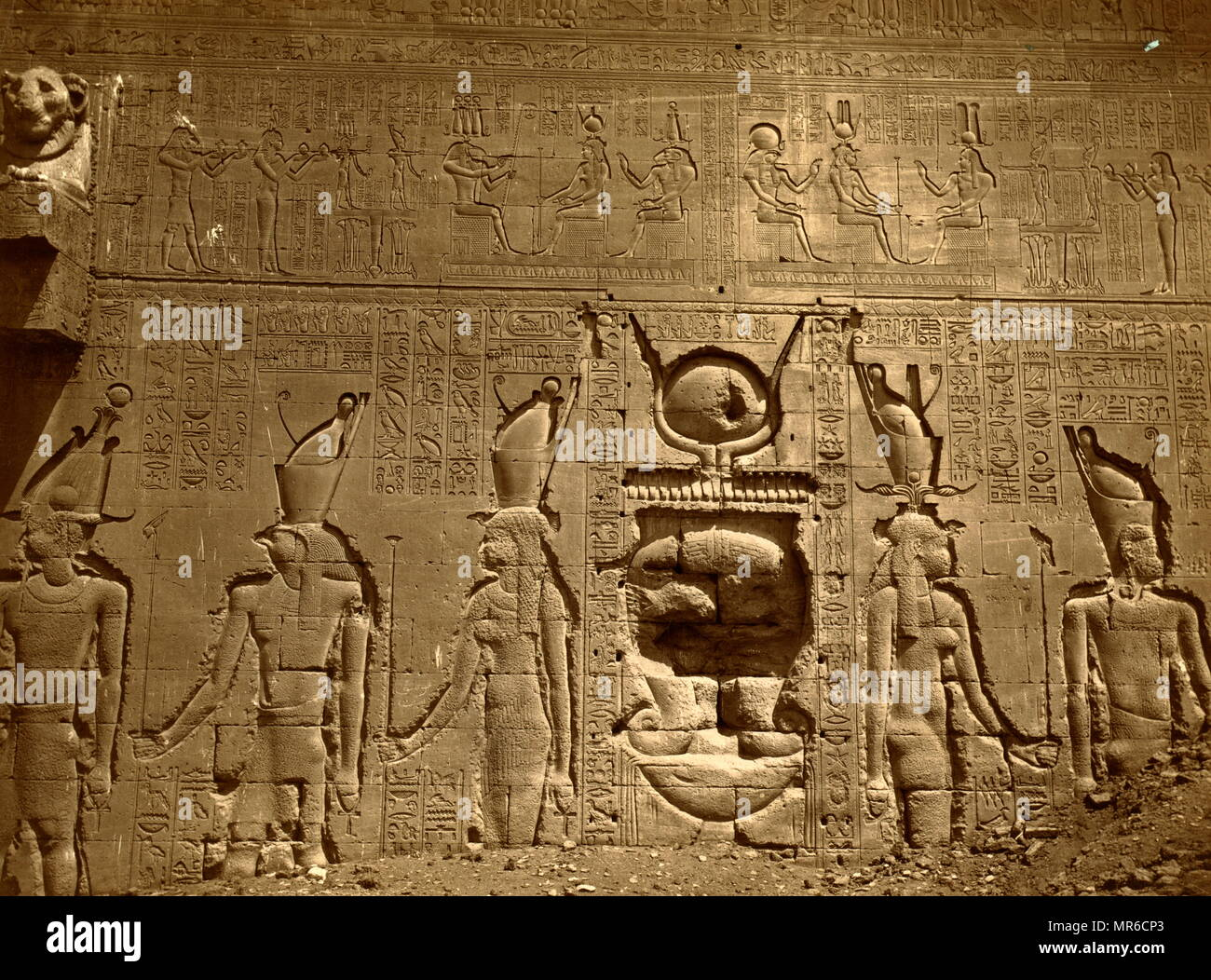 relief with hieroglyphics covers a wall in the Temple of Hathor, located in Dendera, Egypt. Dendera Temple complex. It is one of the best-preserved temple complexes in Egypt. The area was used as the sixth Nome of Upper Egypt, south of Abydos. - Stock Image