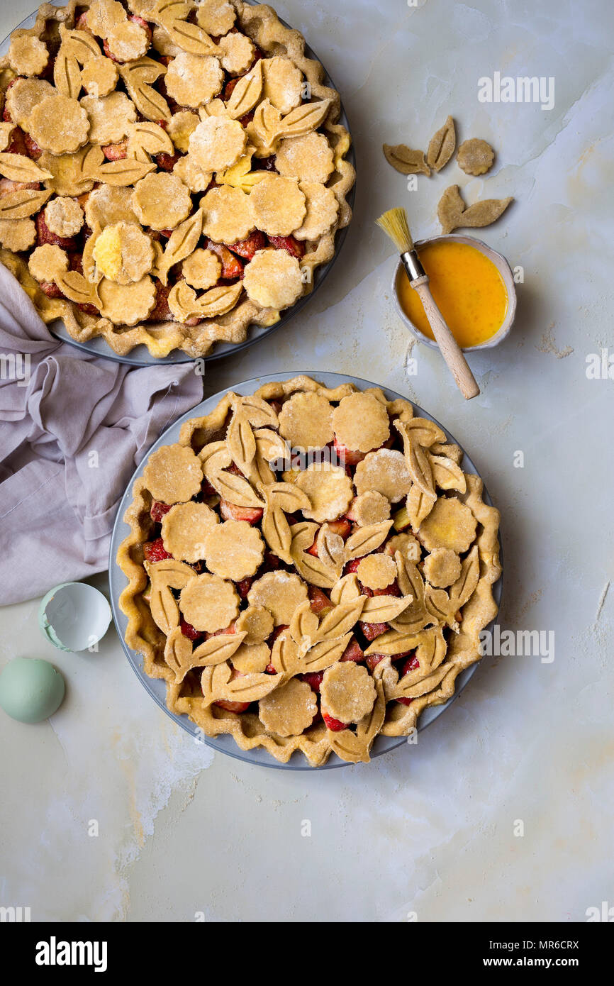 The making of a home made pie with fresh fruit - Stock Image
