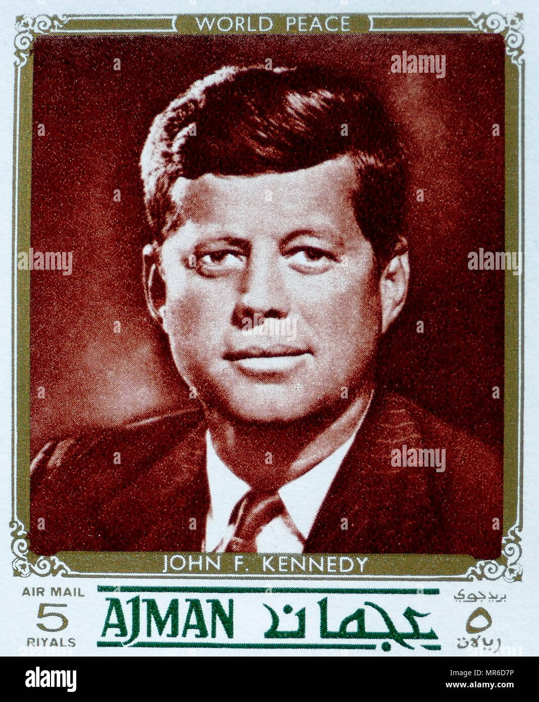 Stamp depicting the American President John F Kennedy, issued by the state of Ajman in the United Arab Emirates - Stock Image