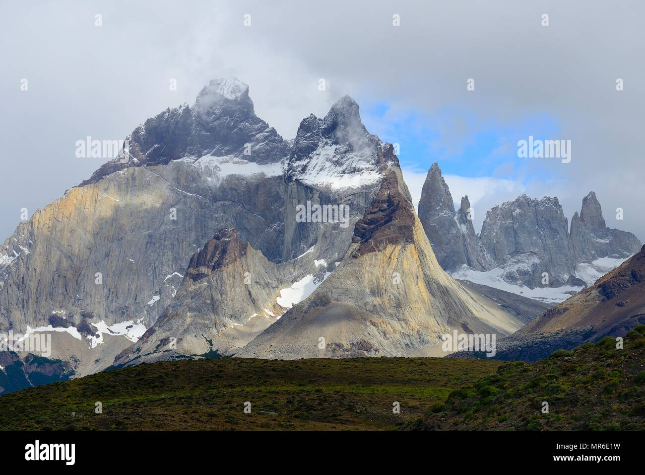 Cuernos del Paine massif with rising clouds, Torres del Paine National Park, Última Esperanza Province, Chile - Stock Image