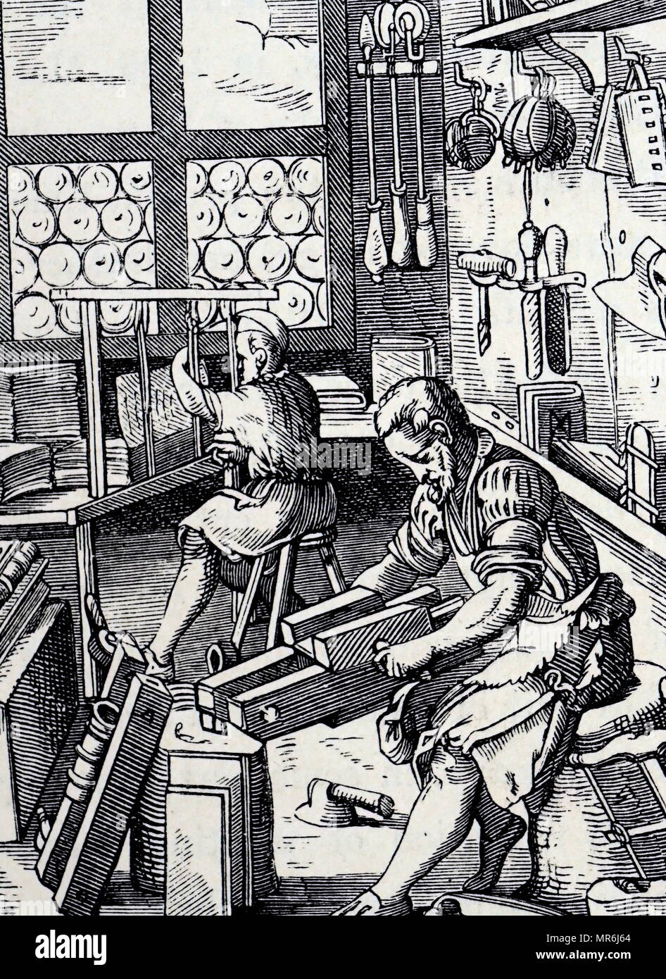 Woodcut engraving depicting a bookbinder's workshop by Jost Amman. Jost  Amman (1539-1591) a Swiss-German artist. Dated 16th century