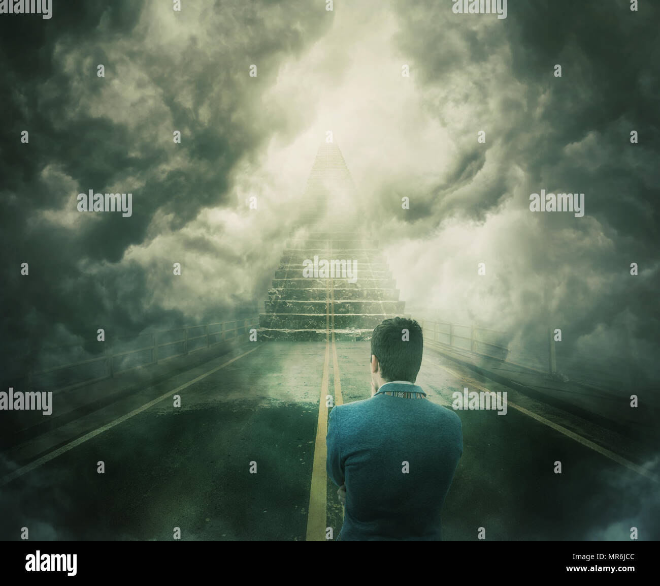 Mystic view as a man stand on the road transforming into a stairway going up to unknown heaven. Difficult decision, concept of the important choice. O - Stock Image