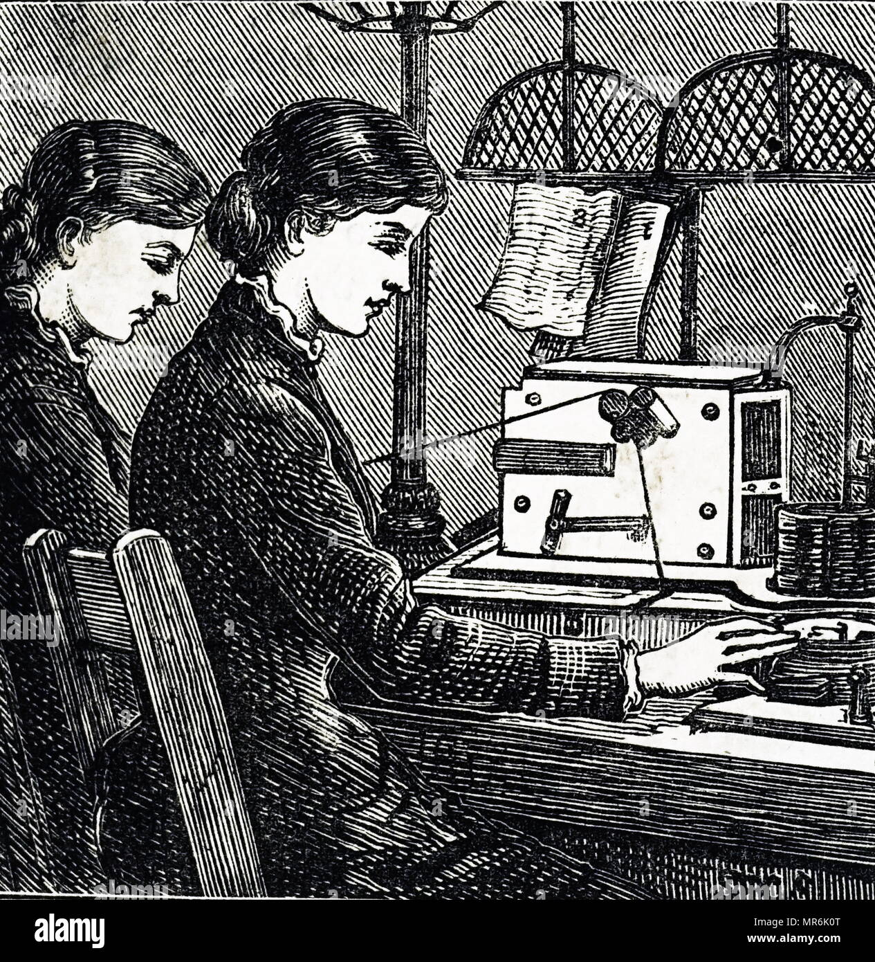 Engraving depicting operators receiving a message on a Morse telegraph at the General Post Office. Dated 19th century - Stock Image
