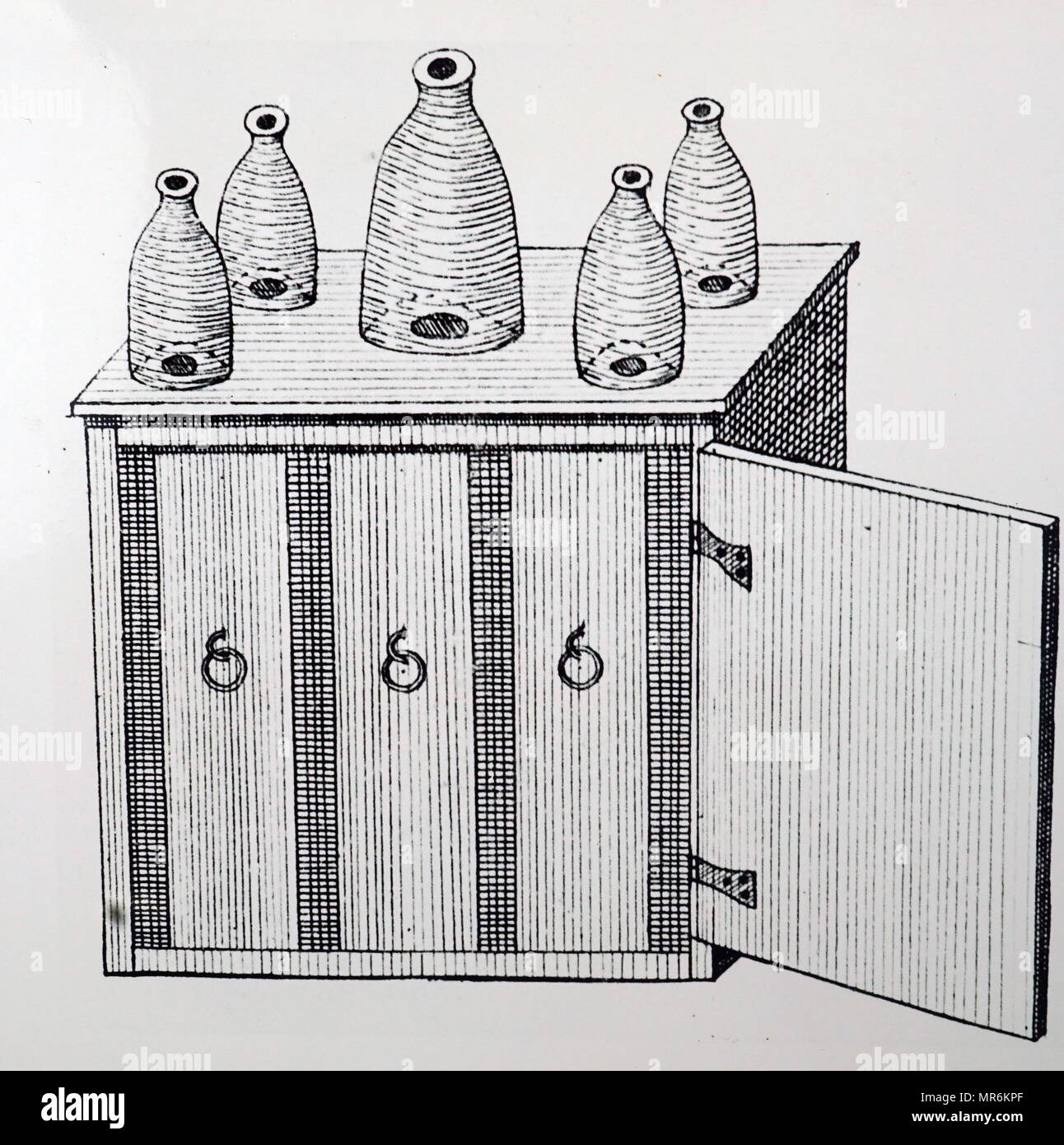 Engraving depicting a beehive with glass side and sections which could be removed. Dated 19th century - Stock Image