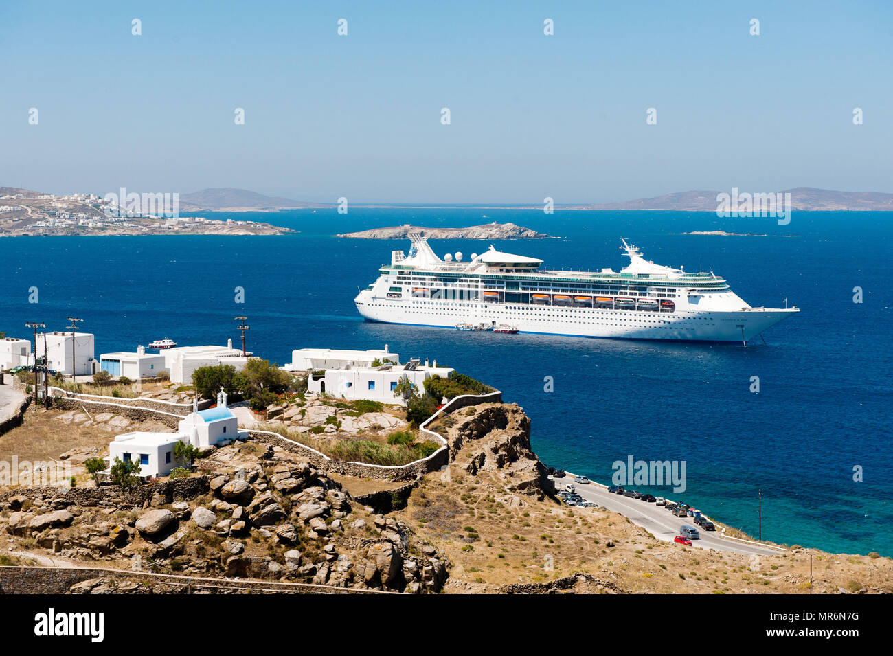 Greece: Mykonos. 2012/06/08 Cruise in the Cyclades MS Grandeur of the Seas, cruise ship owned and operated by Royal Caribbean International, lying at  - Stock Image