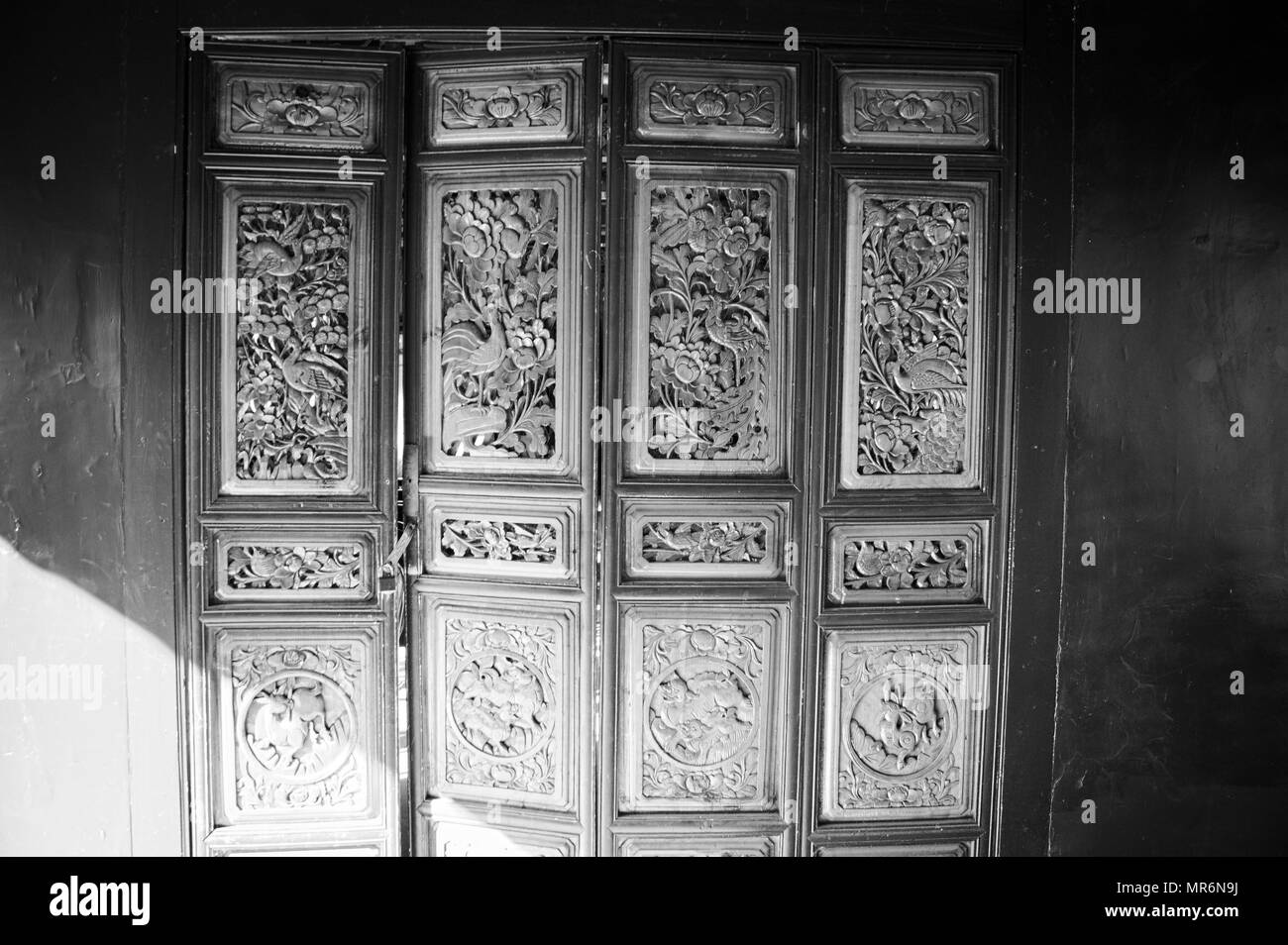 Chinese decorations on the wooden door (Old Town of Lijiang, Yunnan, China) - Stock Image