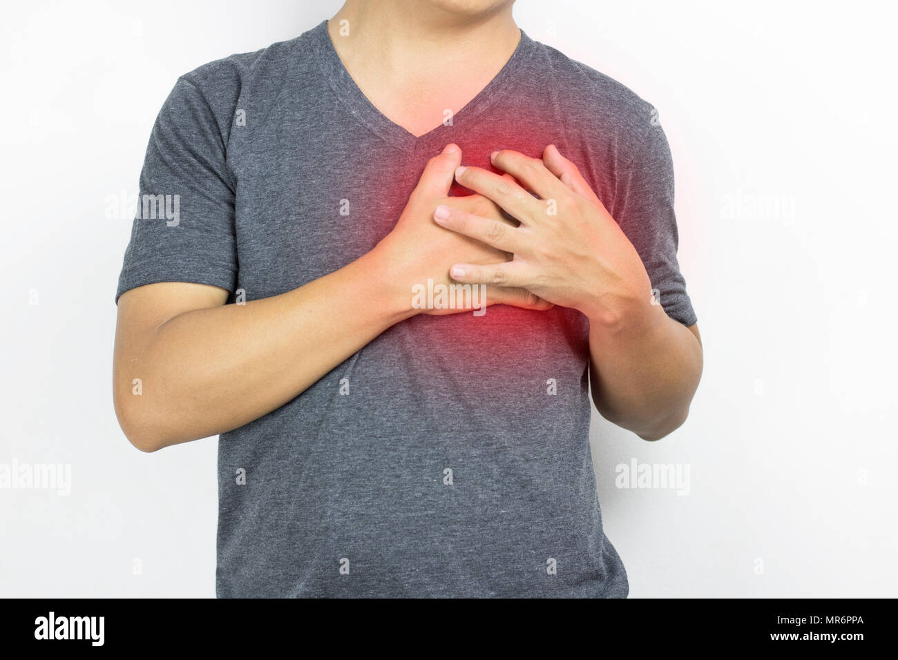 Man, guy has heartache in gray clothe and  hand touch with pain on white background - Stock Image