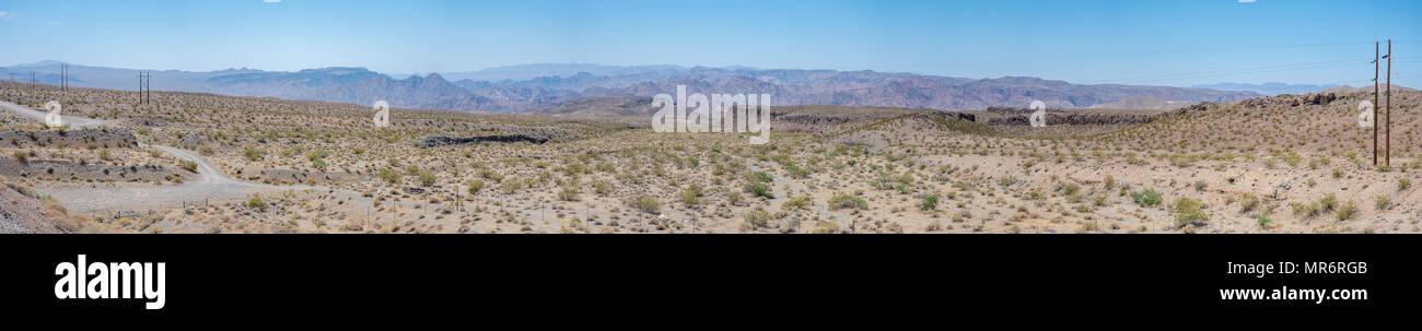 Panorama of small road Through the Nevada Desert - Stock Image