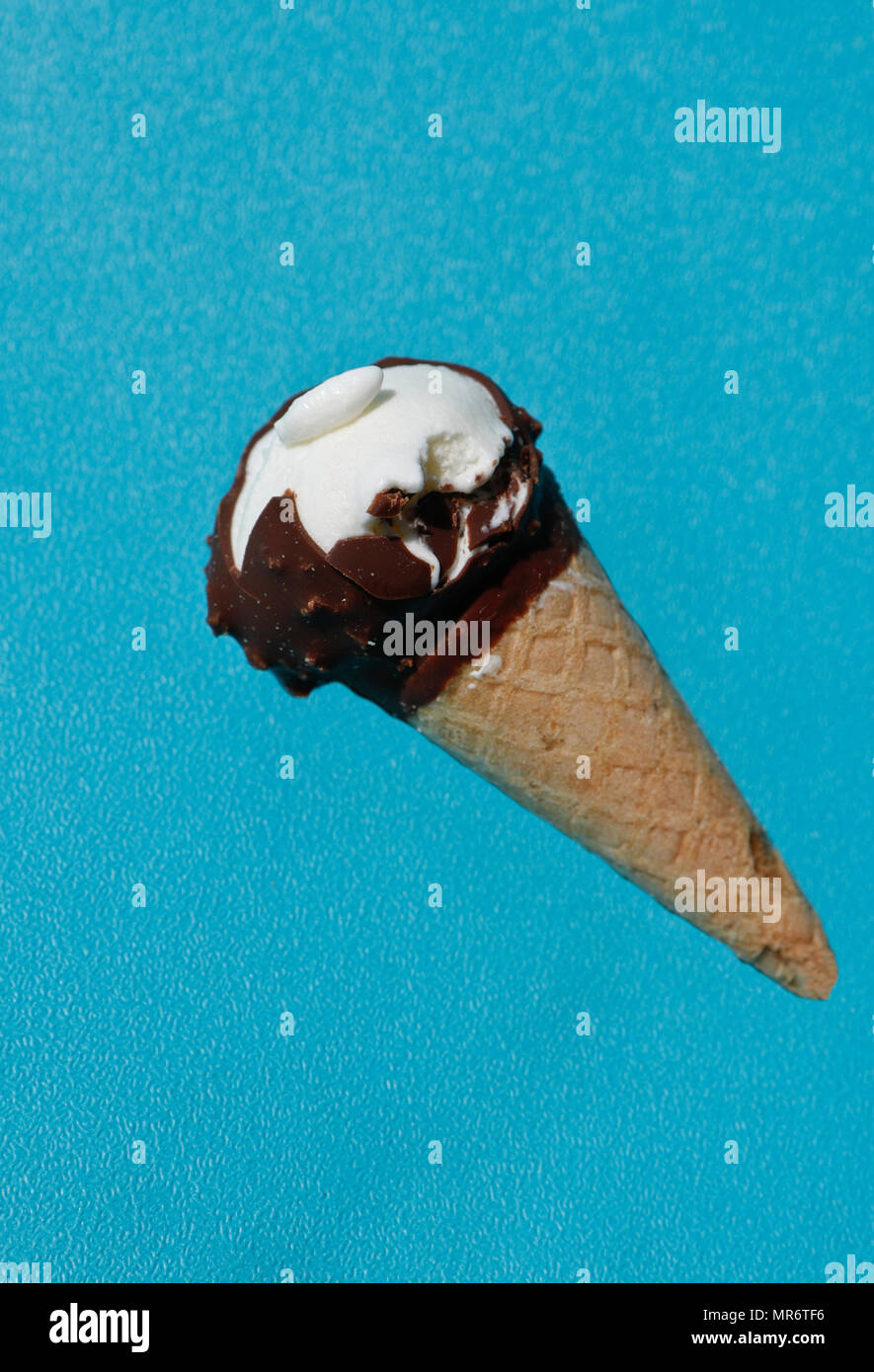 Ice cream cone on colorful background - Stock Image