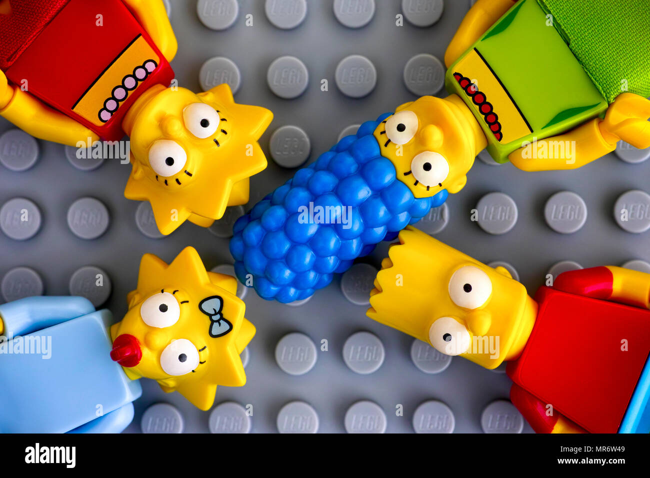 Tambov, Russian Federation - May 20, 2018 Four Lego Simpsons minifigures - Marge, Bart, Lisa, and Maggie, on gray background. Studio shot. - Stock Image