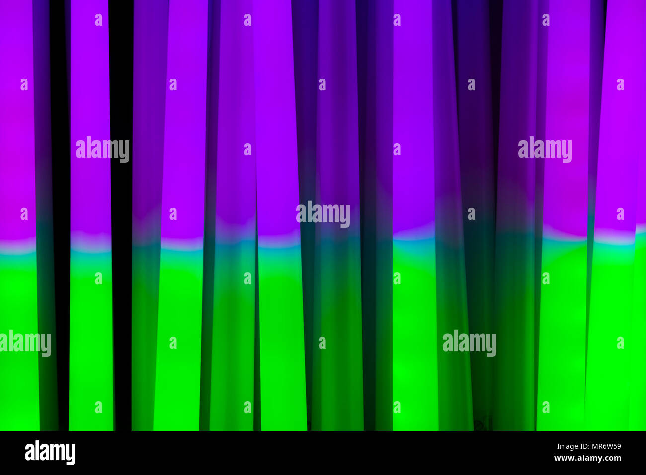 Three fluorescent coloured stripes in green, Blue and purple - Stock Image