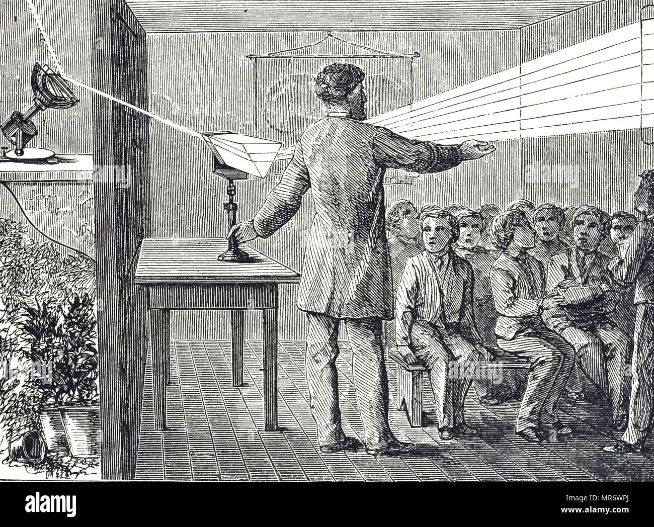 Engraving depicting the solar spectrum being demonstrated to young boys in a darkened room by means of a heliostat and a prism. Dated 19th century - Stock Image