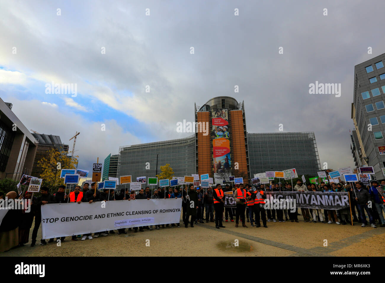 Bangladeshis from European countries demonstrate in front of the European Union headquarters in Brussels calling for an end to the genocide of Rohingy - Stock Image