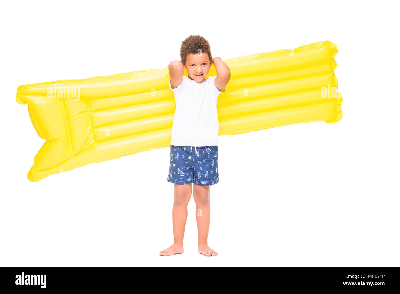 beautiful african american boy holding swimming mattress and looking at camera isolated on white - Stock Image