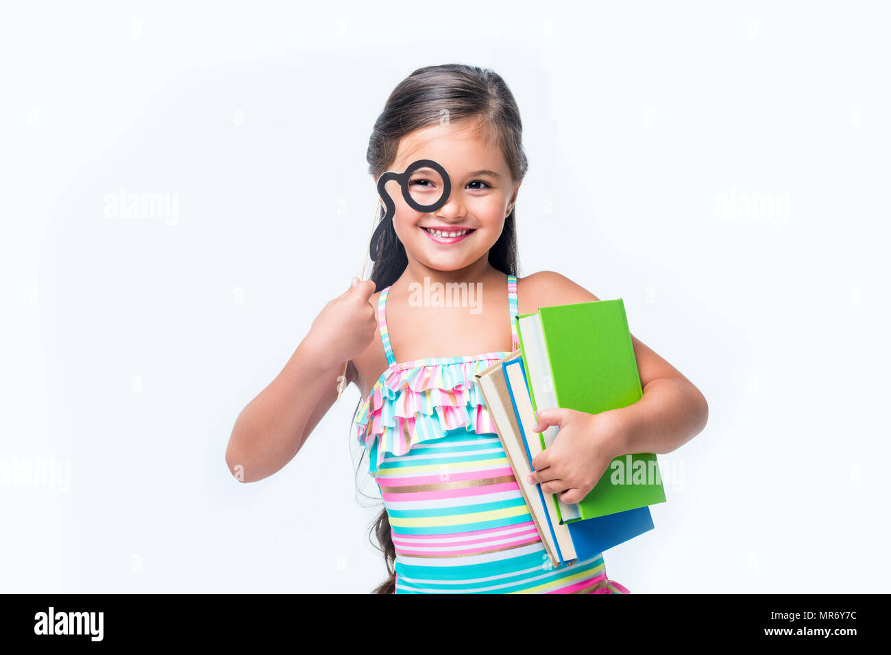 fe5ad7183c adorable happy little girl with books and party stick smiling at camera  isolated on white