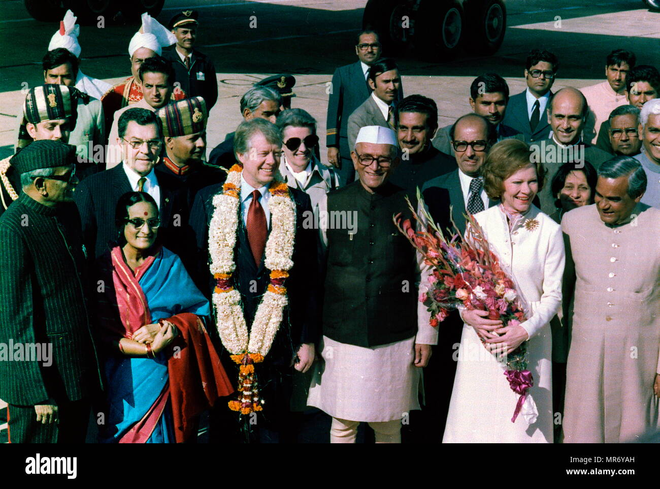 January 1978 visit of US President Jimmy Carter to India. He is welcomed by Prime Minister Moraji Desai standing with Rosalind Carter and Future Indian Prime Minister Atal Bihari Vajpayee, during an arrival ceremony in New Delhi, India - Stock Image