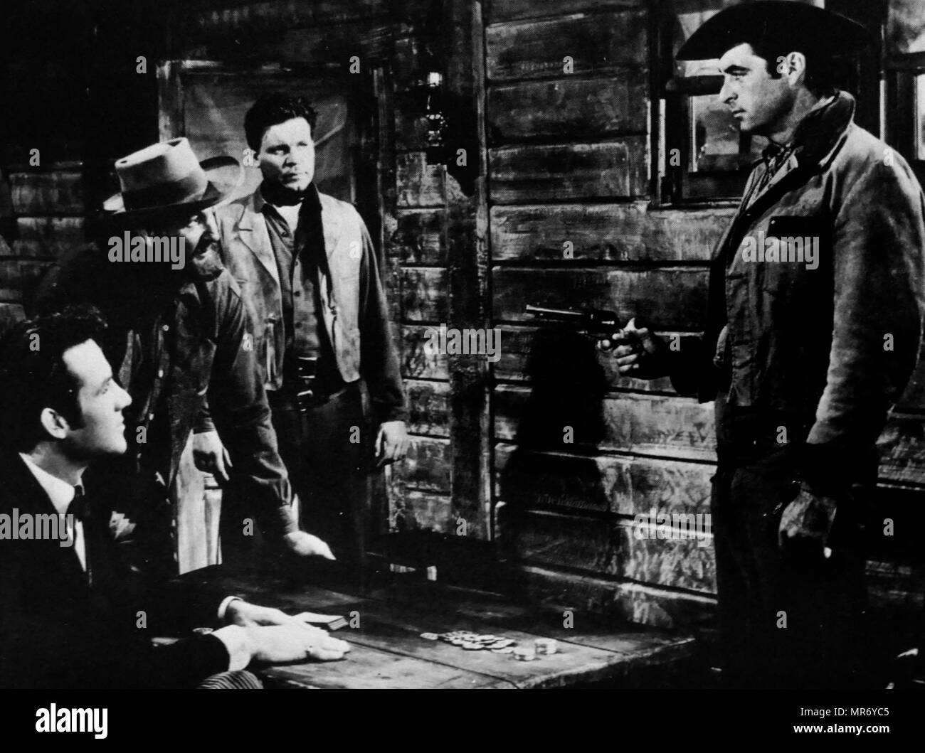 Raw Edge' a 1956 Technicolor Western film directed by John Sherwood starring Rory Calhoun (Right), Yvonne de Carlo, Mara Corday, Rex Reason, Neville Brand. It marked the movie debut of John Gavin under the name 'John Gilmore'. - Stock Image