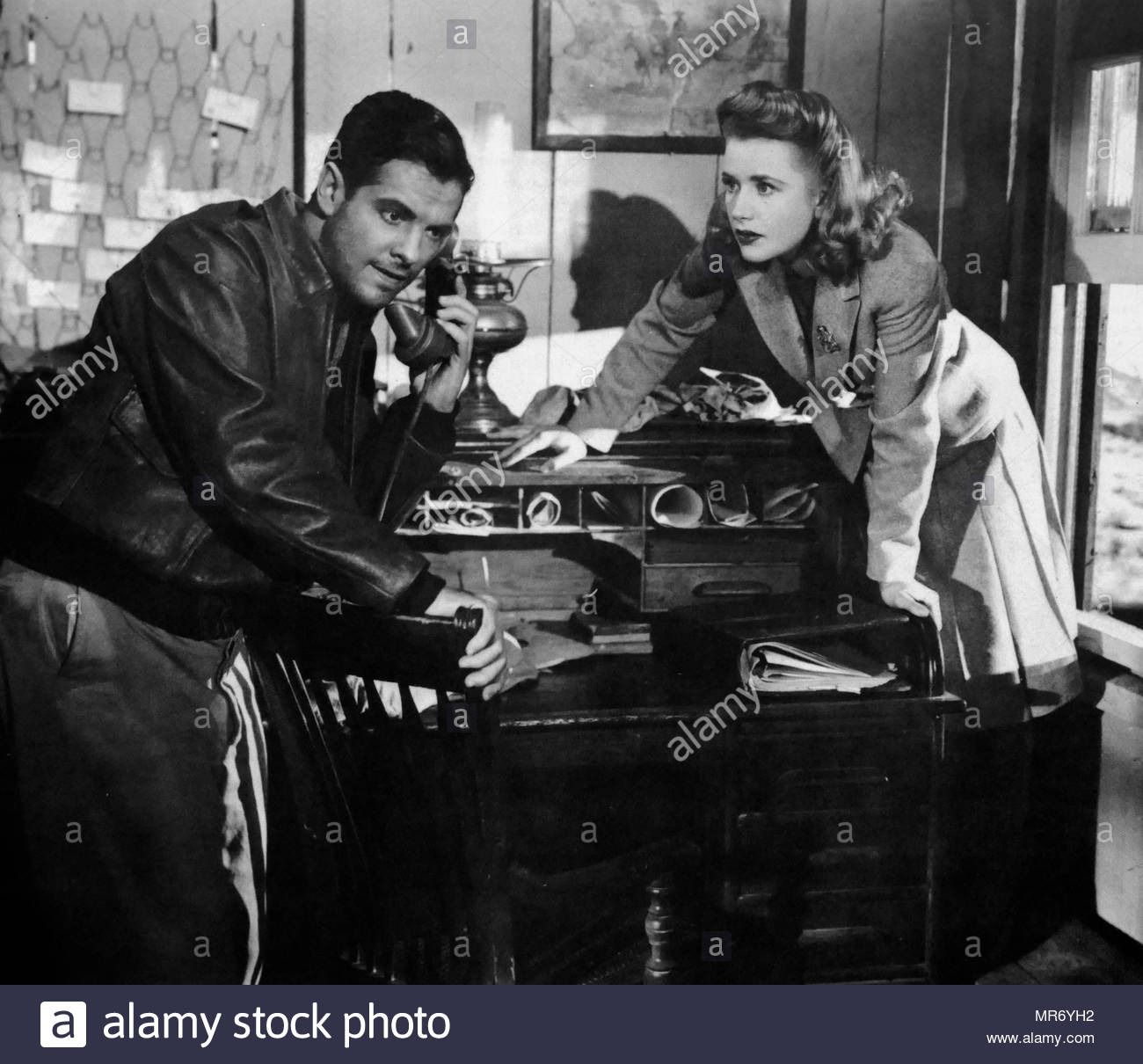 Saboteur is a 1942 American film noir spy thriller film directed by Alfred Hitchcock with a screenplay written by Peter Viertel, Joan Harrison and Dorothy Parker. The film stars Priscilla Lane, and Robert Cummings - Stock Image