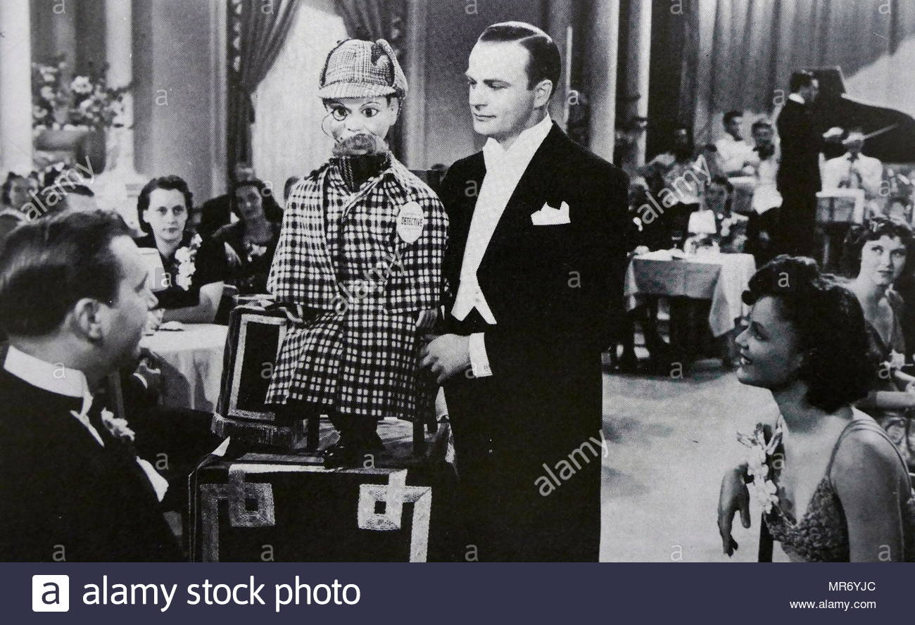 1939 film 'Charlie McCarthy, Detective' starring Edgar John Bergen (1903 – 1978), an American actor, comedian and radio performer, best known for his proficiency in ventriloquism and his character Charlie McCarthy - Stock Image