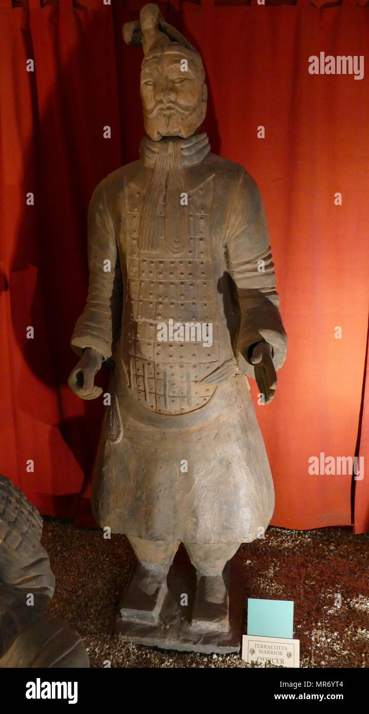 Reproduction of a figure from the Terracotta Army  of soldier and horse, funerary statues, depicting the armies of Qin Shi Huang, the first Emperor of China. It is a form of funerary art buried with the emperor in 210–209 BCE and whose purpose was to protect the emperor in his afterlife. The figures, dating from approximately the late third century BCE, were discovered in 1974 by local farmers in Lintong District, Xi'an, Shaanxi province. - Stock Image