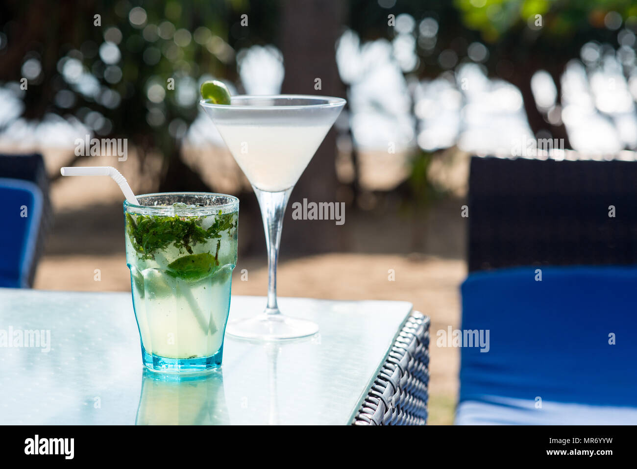 close-up shot of margarita and mojito cocktails standing on table of restaurant - Stock Image