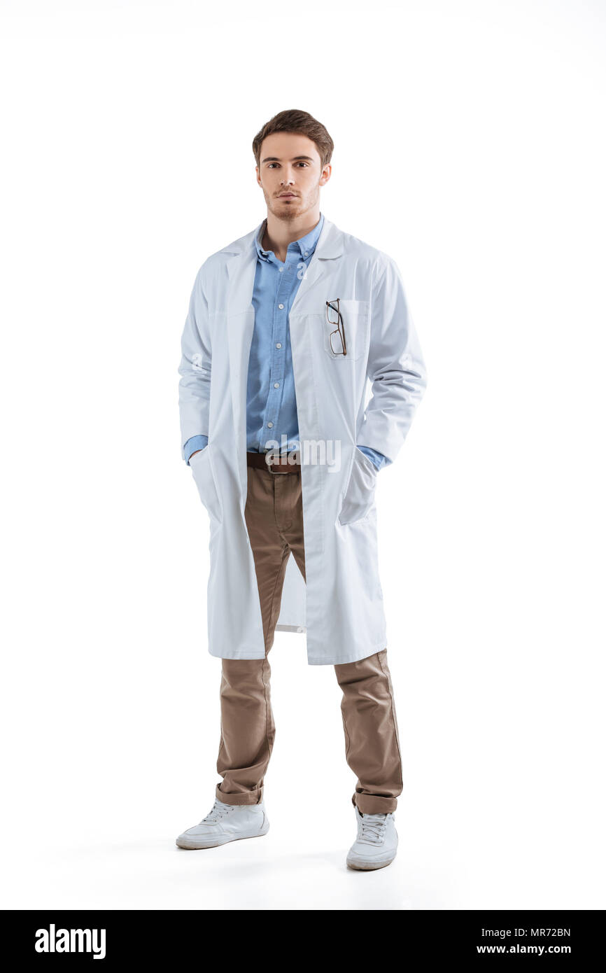 young male chemist in white coat, isolated on white - Stock Image